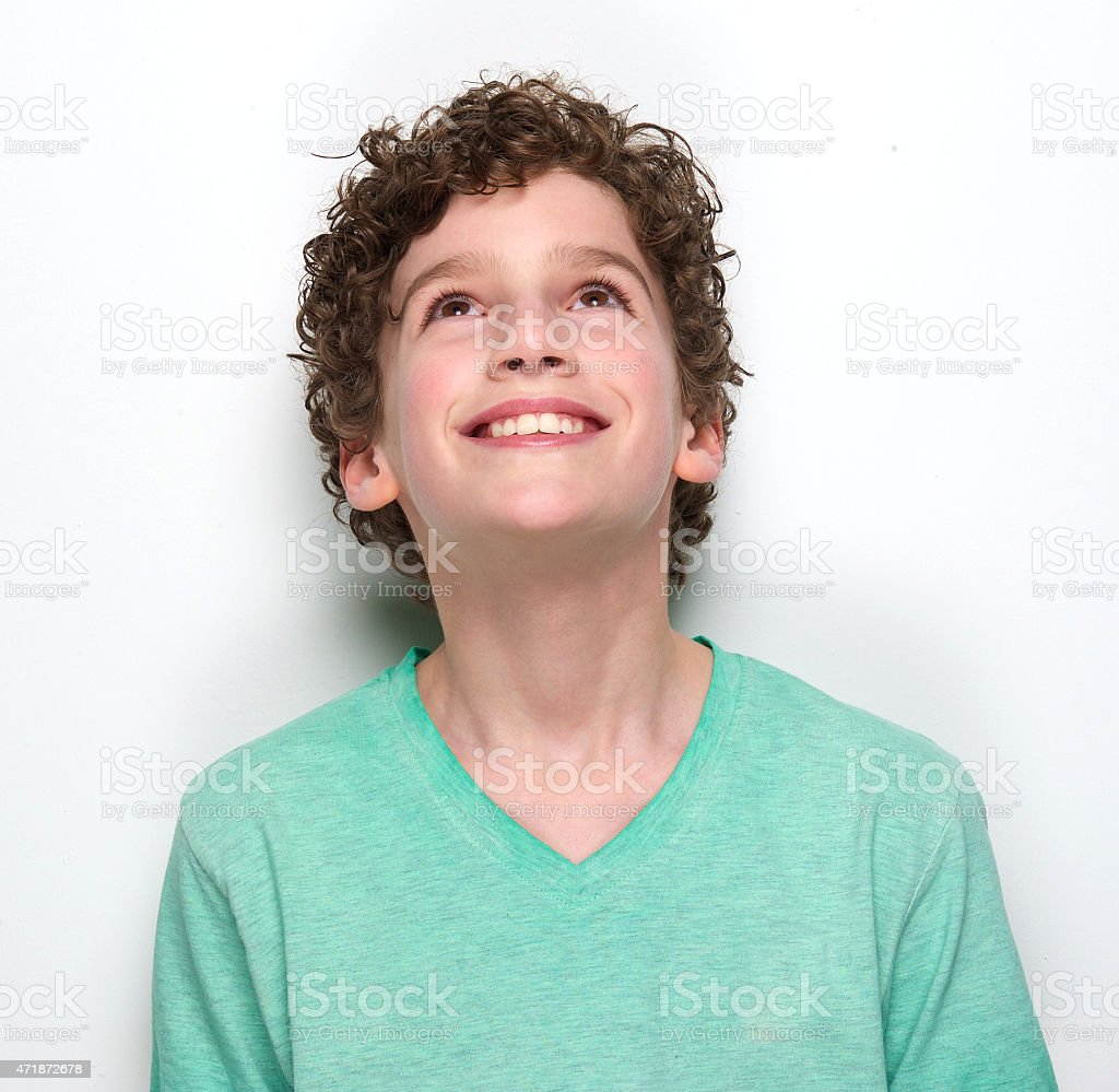 Smiling boy looking up stock photo