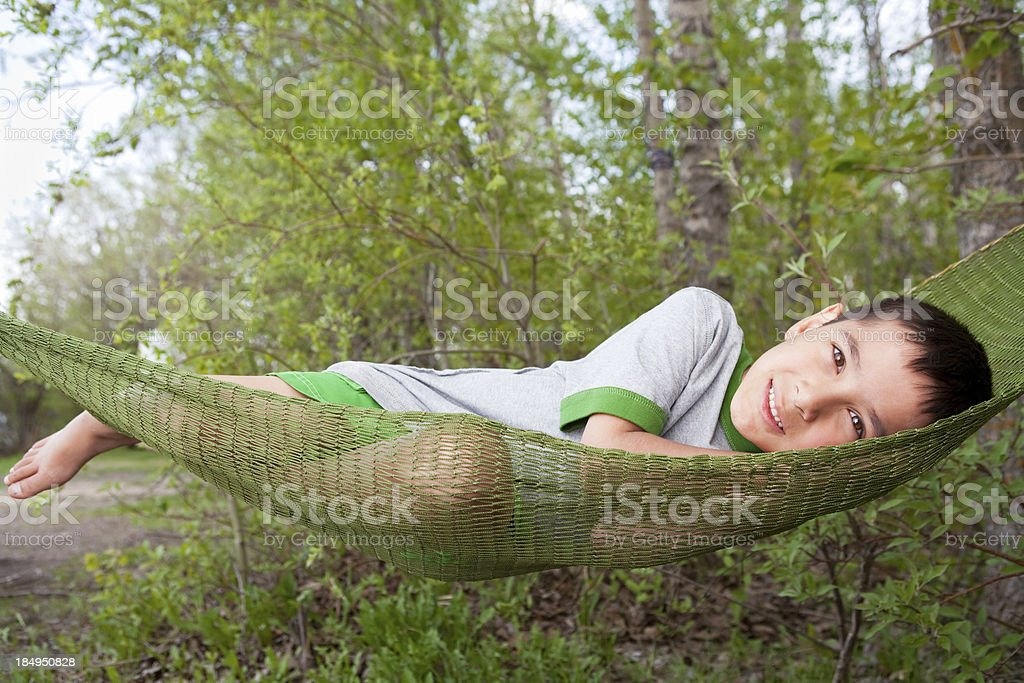 Smiling boy on hammock stock photo