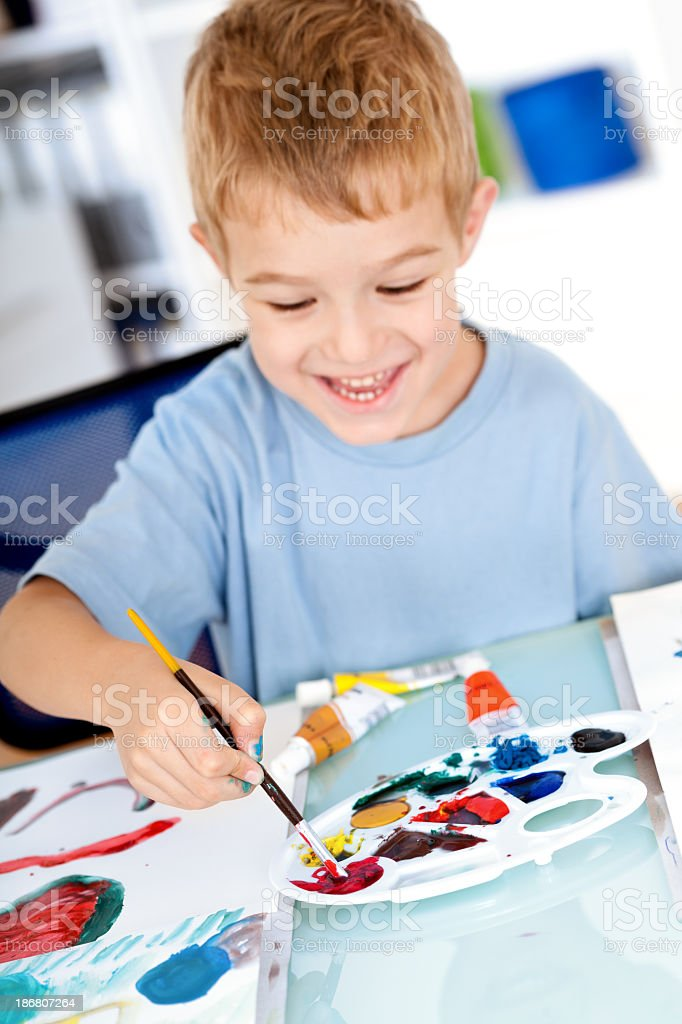 Smiling boy painting royalty-free stock photo