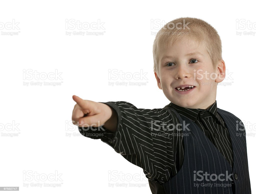 Smiling boy pointing forward royalty-free stock photo
