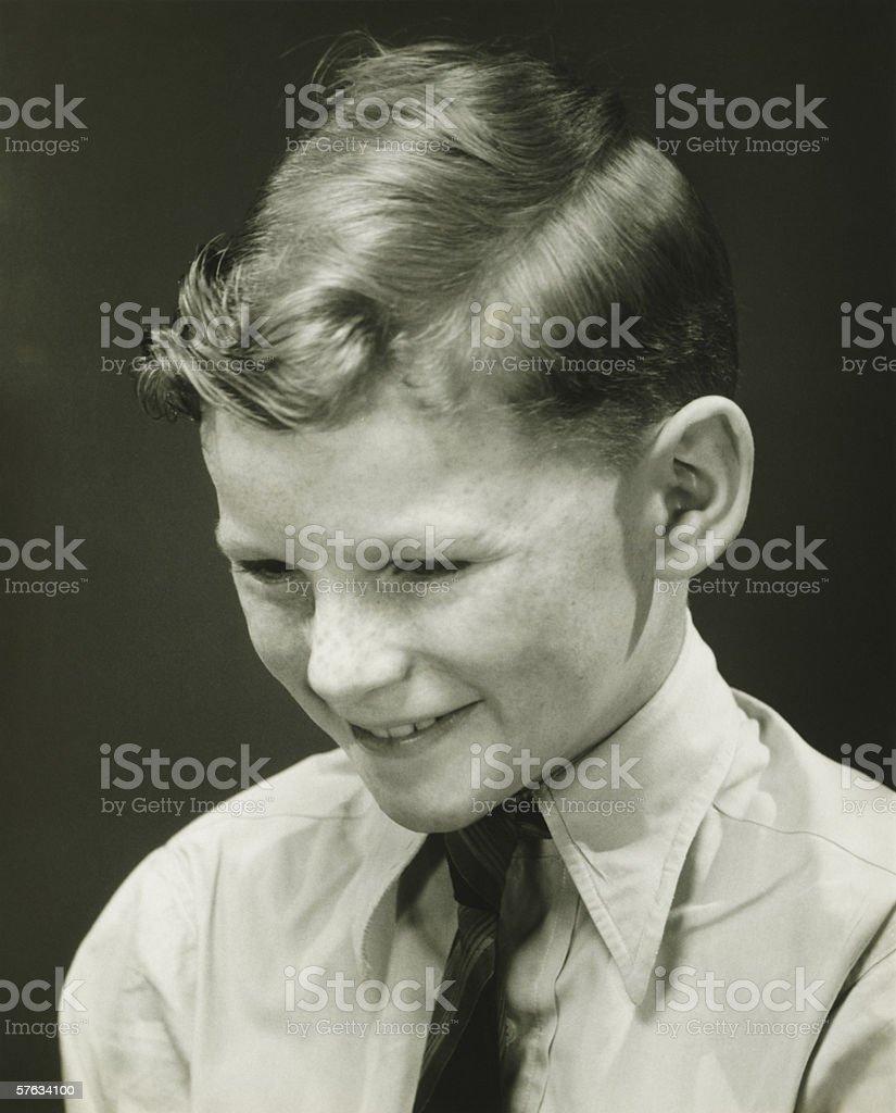 Smiling boy (10-11) posing in studio, (B&W), portrait royalty-free stock photo