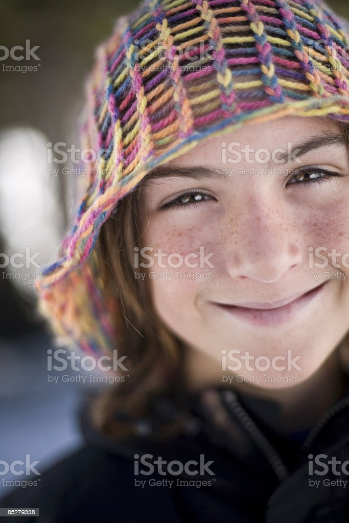 A smiling boy wearing a colorful hat. royalty-free stock photo