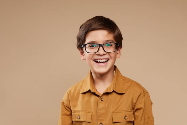 Smiling Boy wearing Glasses in Studio stock photo