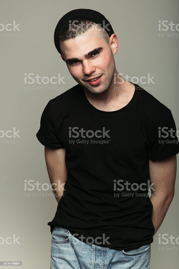 Smiling boy with arms behind back stock photo