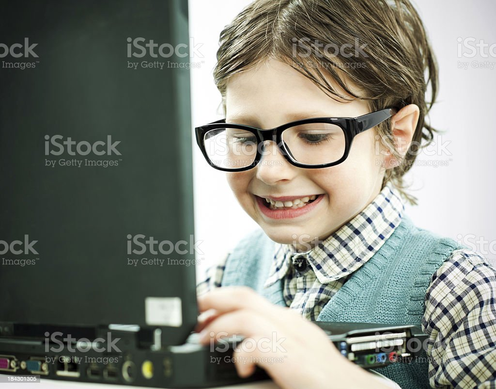 Smiling boy working on his computer. royalty-free stock photo