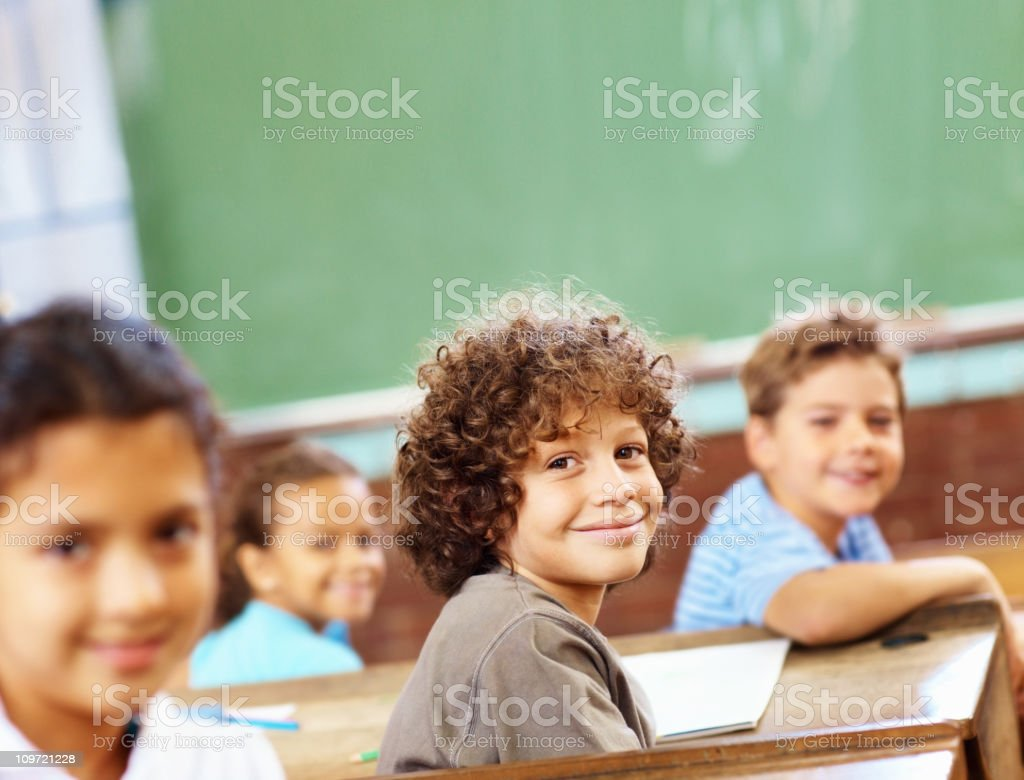 Smiling boys and girls in the classroom royalty-free stock photo