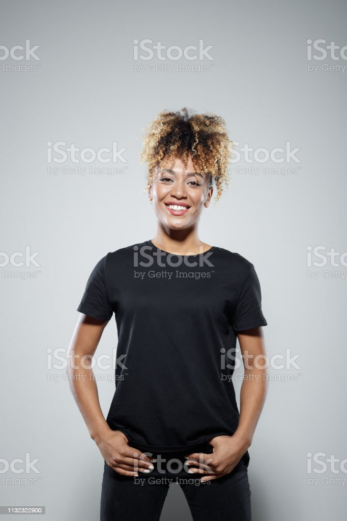 Smiling brave woman wearing black clothes Portrait of smiling brave woman wearing black clothes. Beautiful female is supporting Me Too movement. She is standing against gray background. 30-34 Years Stock Photo