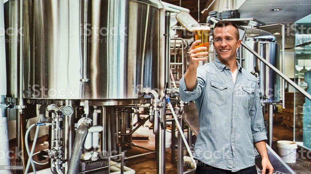Smiling brewmaster holding beer...