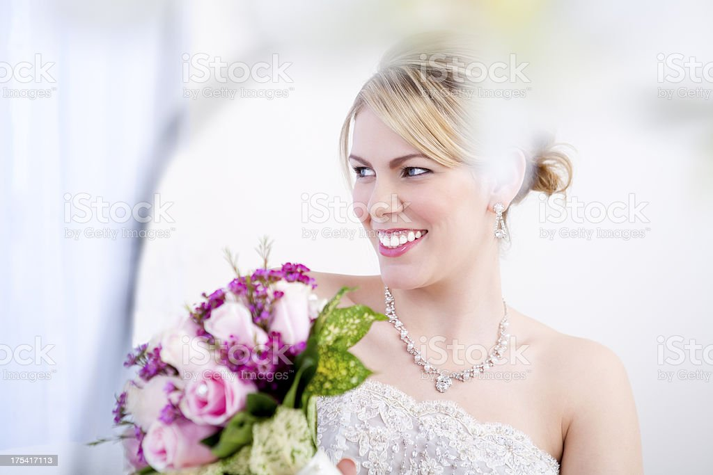 Smiling bride holding pink bouquet royalty-free stock photo