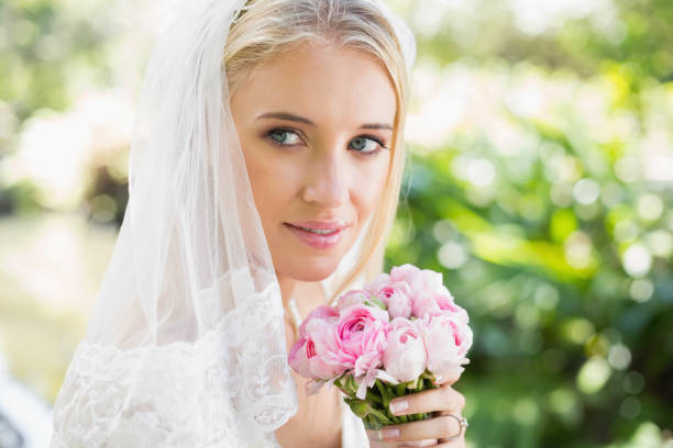 e1339b729a3c9 Smiling Bride Wearing Veil Holding Bouquet Stock Photo & More ...