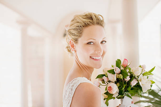 Smiling bride with bouquet stock photo
