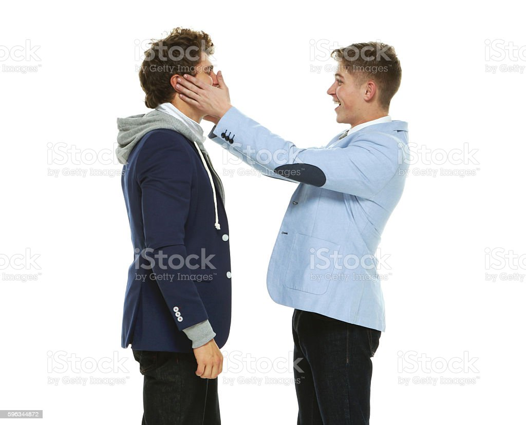 Smiling brothers being silly royalty-free stock photo