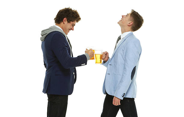 Smiling brothers drinking alcohol together - foto de stock