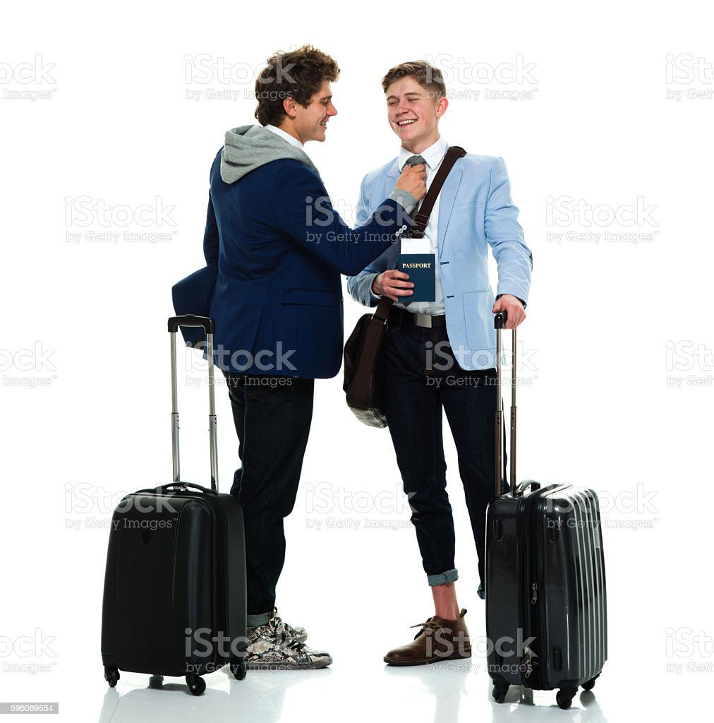 Smiling brothers helping dress royalty-free stock photo
