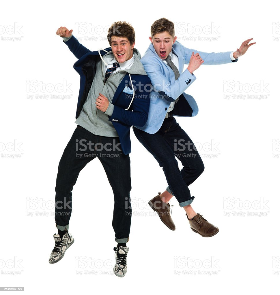 Smiling brothers jumping royalty-free stock photo