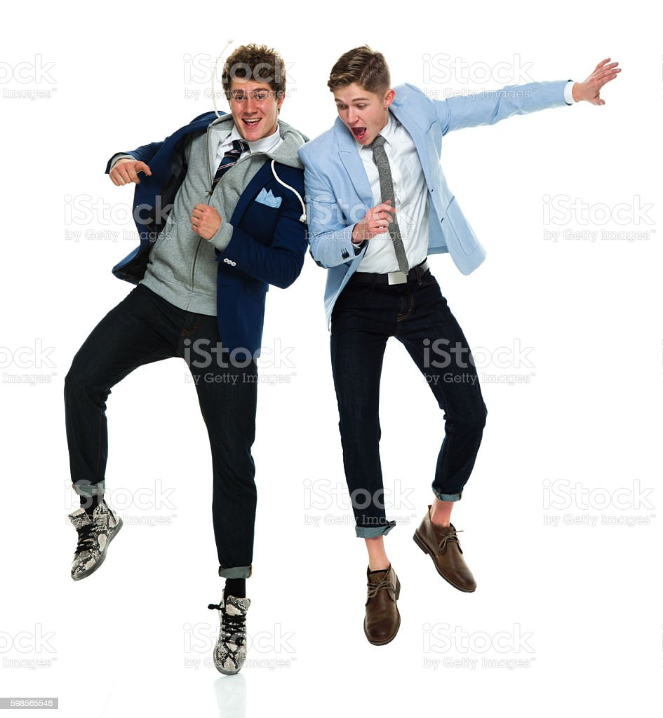 Smiling brothers jumping stock photo