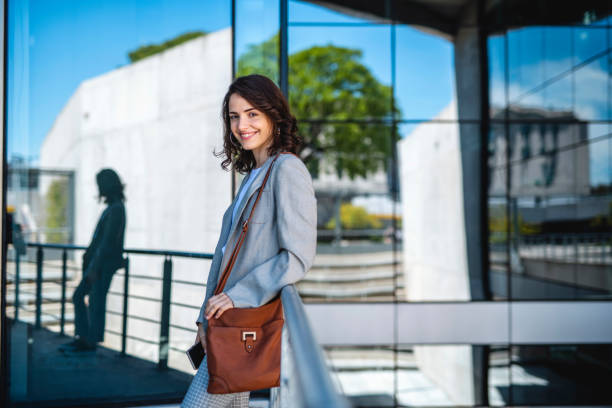 Smiling Brunette Businesswoman Taking Classes on Campus stock photo