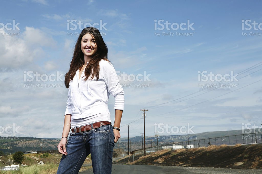 Smiling Brunette Girl Outside on a Side Road royalty-free stock photo