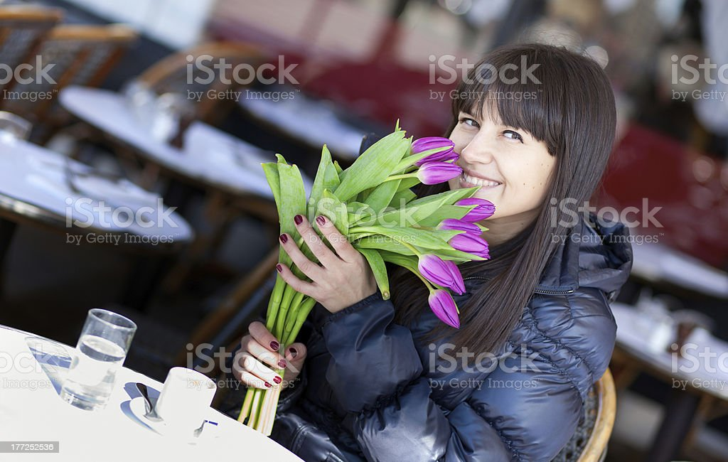 Smiling brunette lady with beautiful tulips royalty-free stock photo