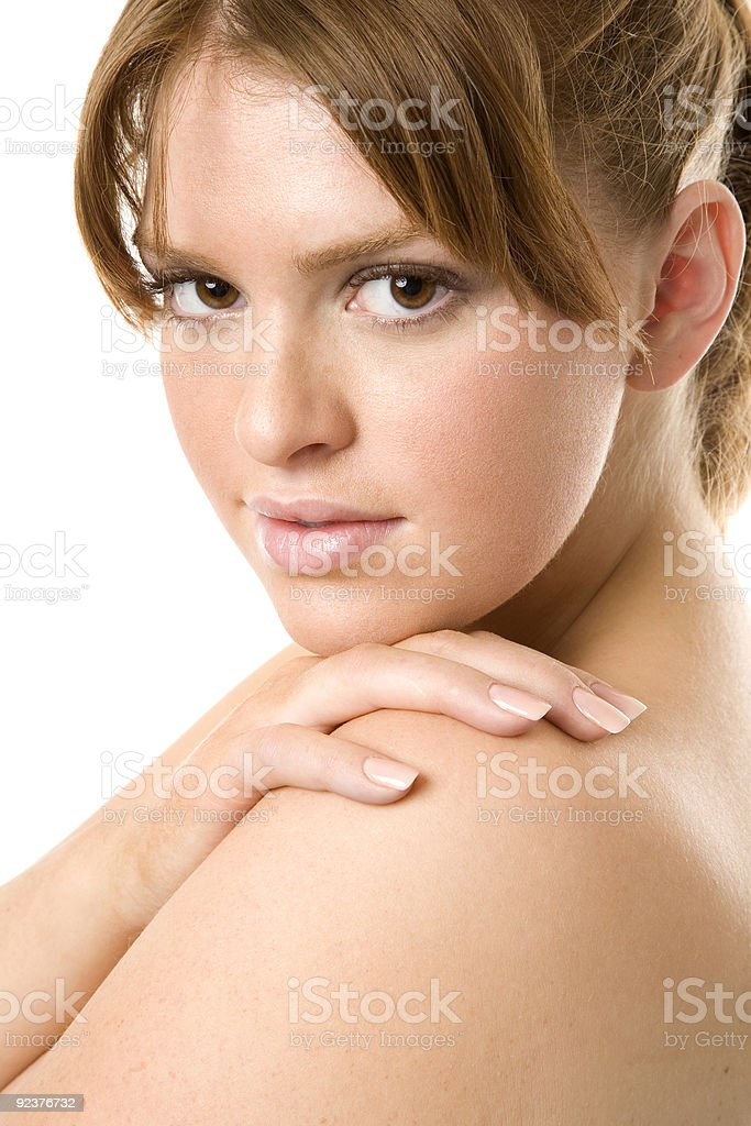 Smiling Brunette looks over her shoulder royalty-free stock photo