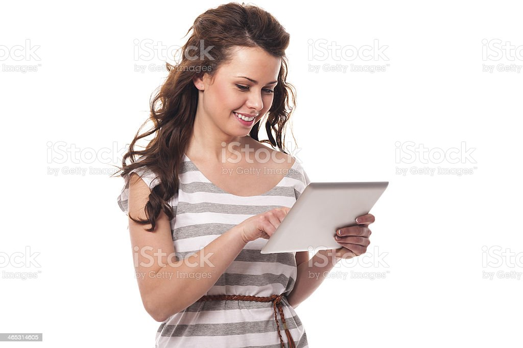 Smiling brunette using digital tablet royalty-free stock photo