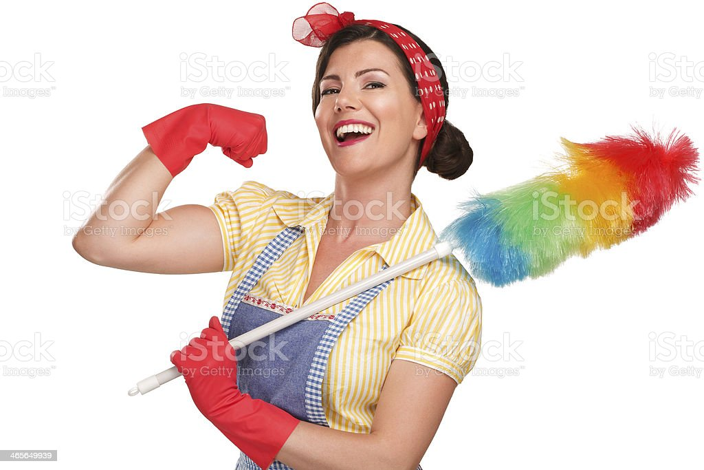 Smiling brunette woman doing the Rosie the Riveter pose  stock photo