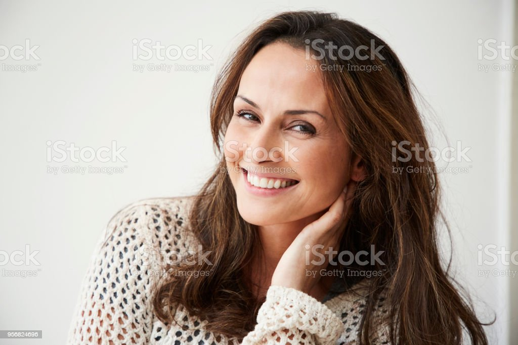 Smiling brunette woman stock photo
