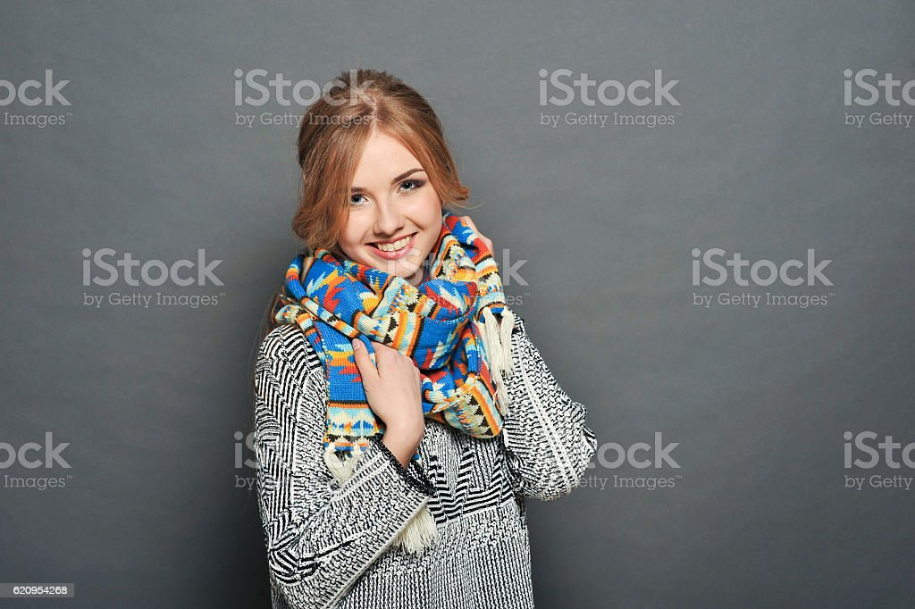 smiling brunette woman wearing knitted sweater - Photo