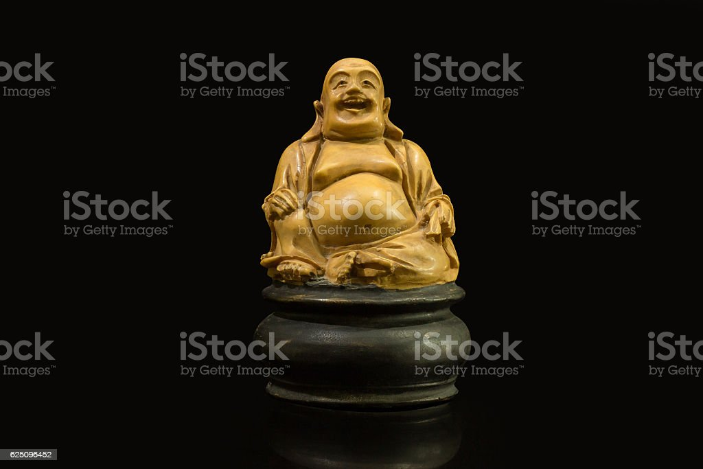 smiling Buddha made from stock photo