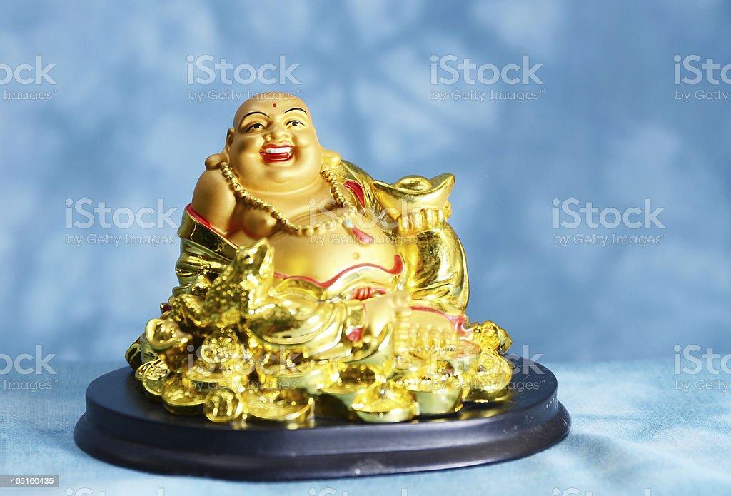 Smiling Buddha statue stock photo