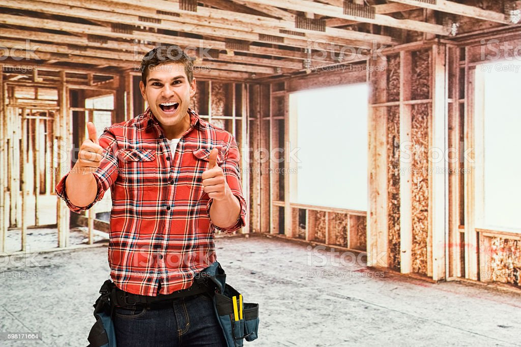 Smiling building contractor giving thumbs...