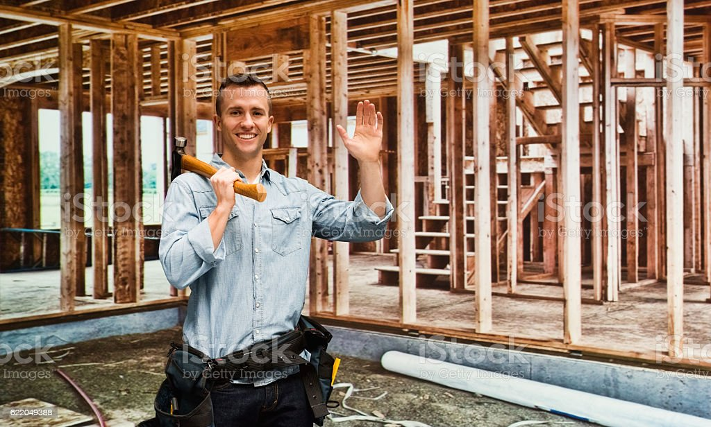 Smiling building contractor waving hand