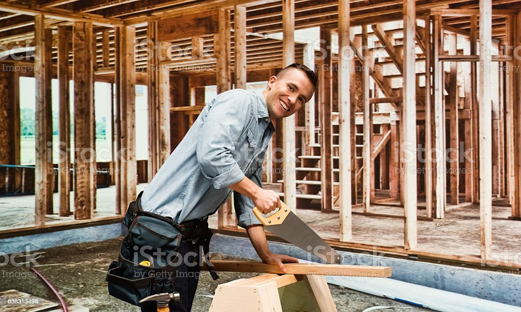 Smiling building contractor working