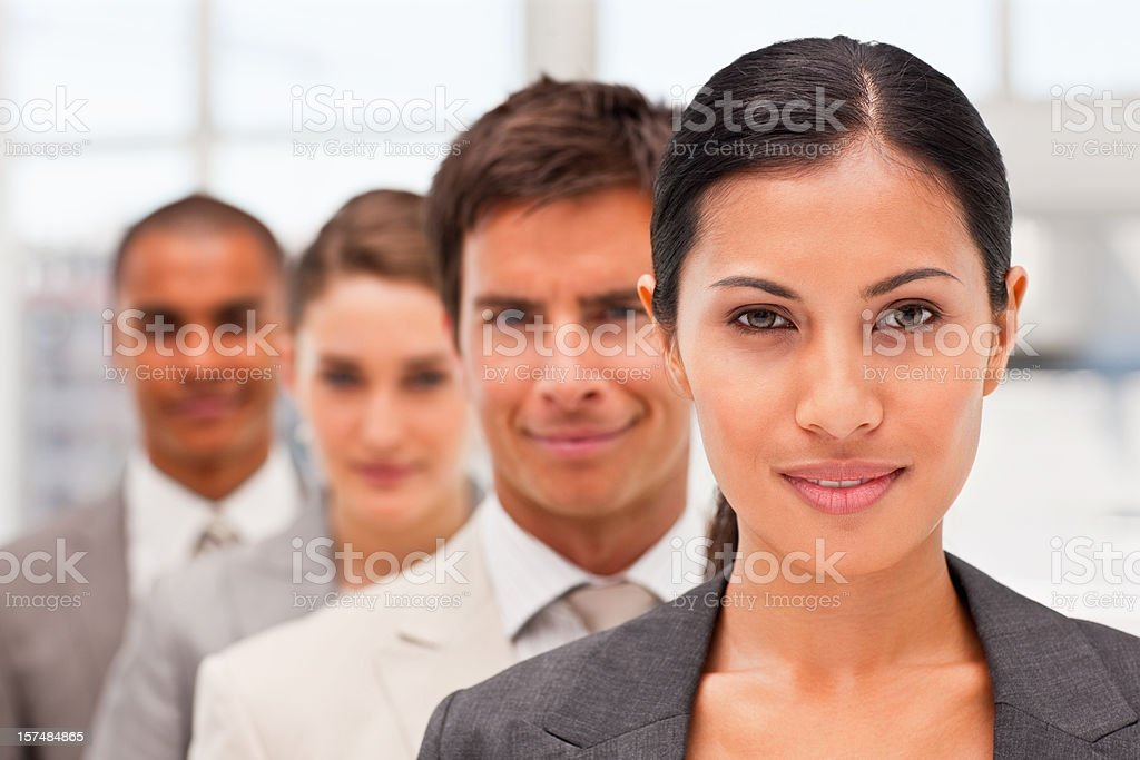 Smiling business colleagues standing in a row royalty-free stock photo