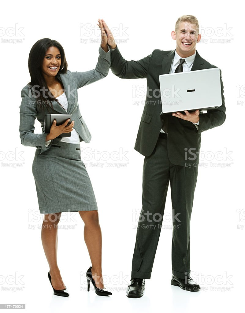 Smiling business couple giving high five stock photo