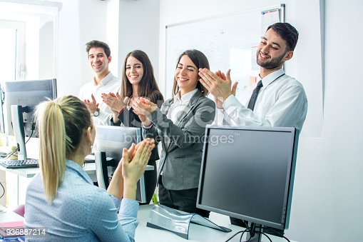913332100 istock photo Smiling business group clapping hands at the meeting 936887214