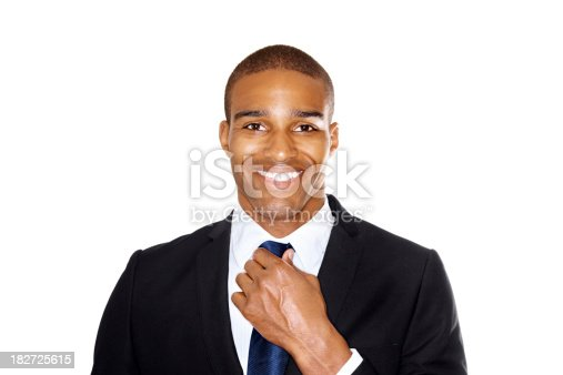 973213156istockphoto Smiling business man adjusting his tie against white 182725615
