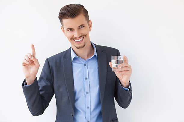 smiling business man asking for attention - leitungswasser trinken stock-fotos und bilder
