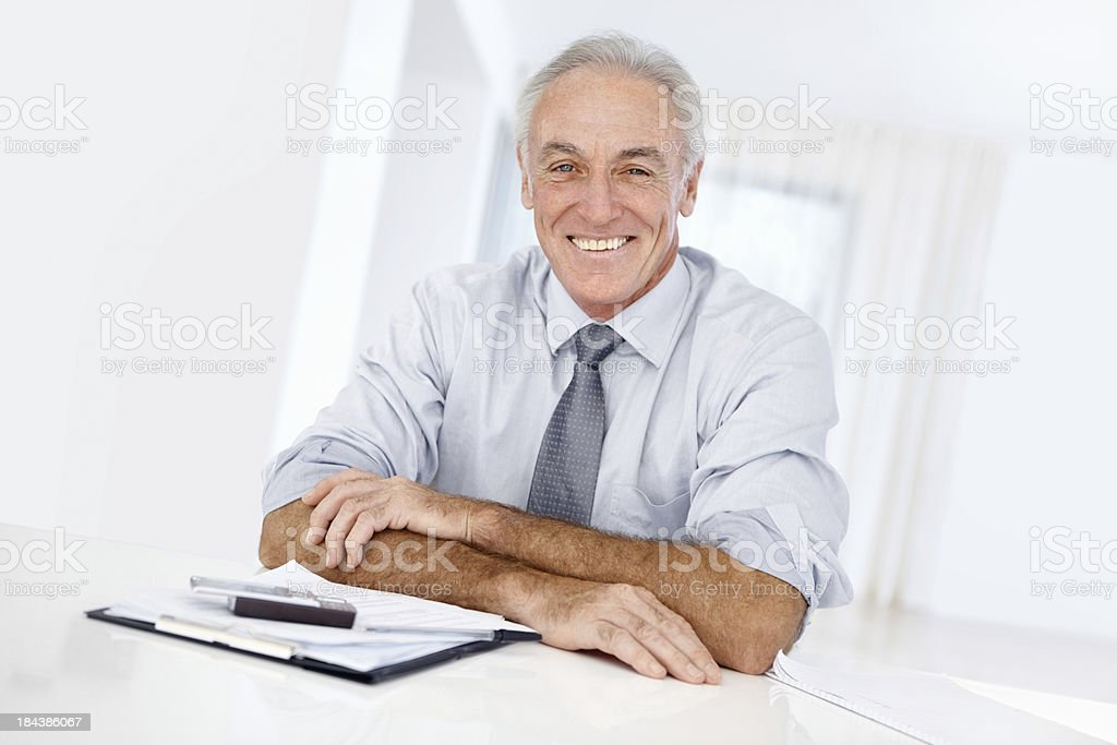 Smiling business man at office desk royalty-free stock photo
