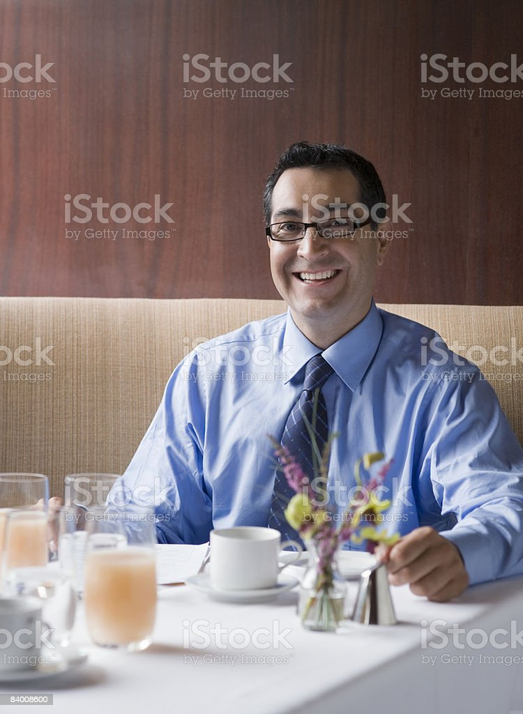 Smiling business man in booth in restaurant. royalty-free stock photo