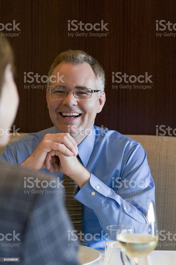 Smiling business man in restaurant. royalty-free stock photo