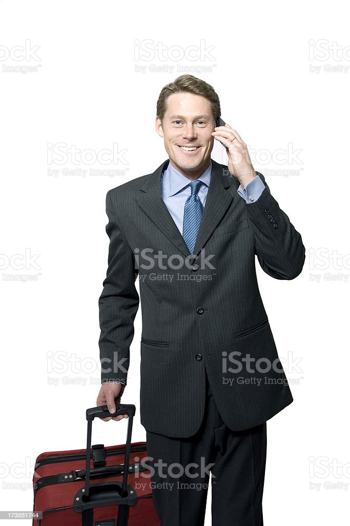 Smiling Business Man Pulling Suitcase royalty-free stock photo