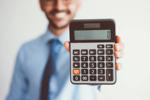smiling business man showing zero on calculator - zero stock pictures, royalty-free photos & images