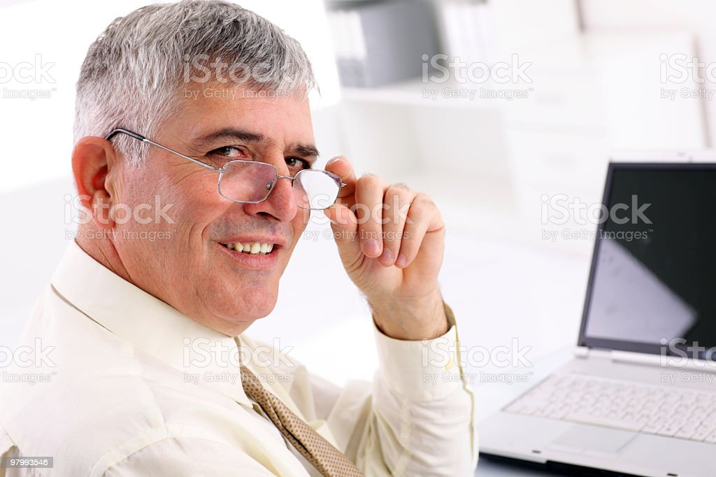 Smiling business man turning to camera. royalty-free stock photo