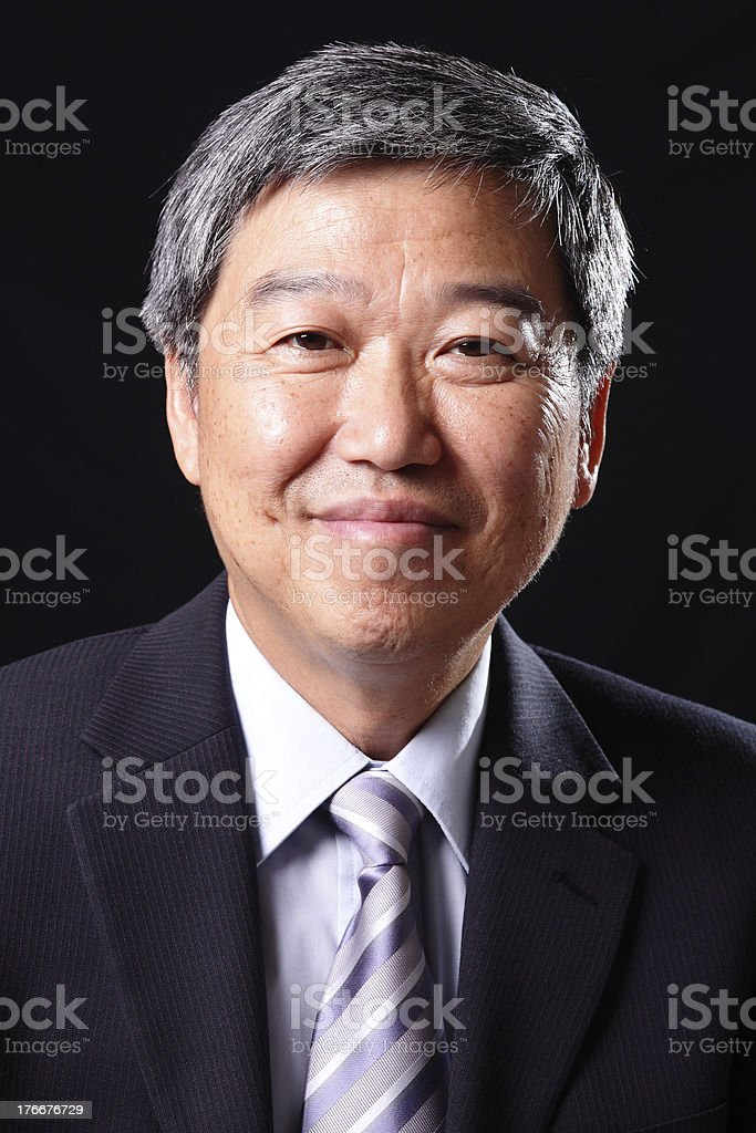 A smiling business man wearing a suit royalty-free stock photo