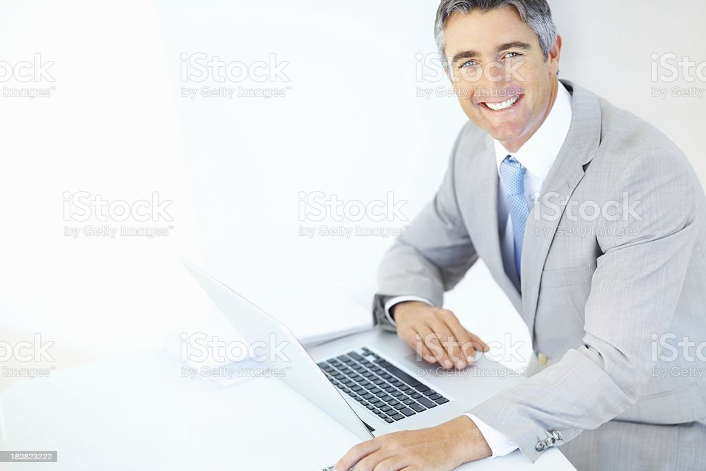 Smiling business man with a laptop stock photo