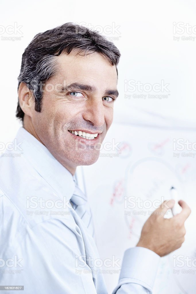 Smiling business man with a plan looking at you royalty-free stock photo