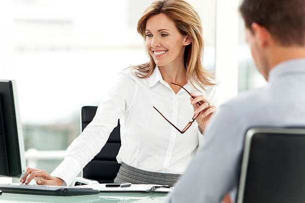 smiling business manager at workplace - bankers stock photos and pictures