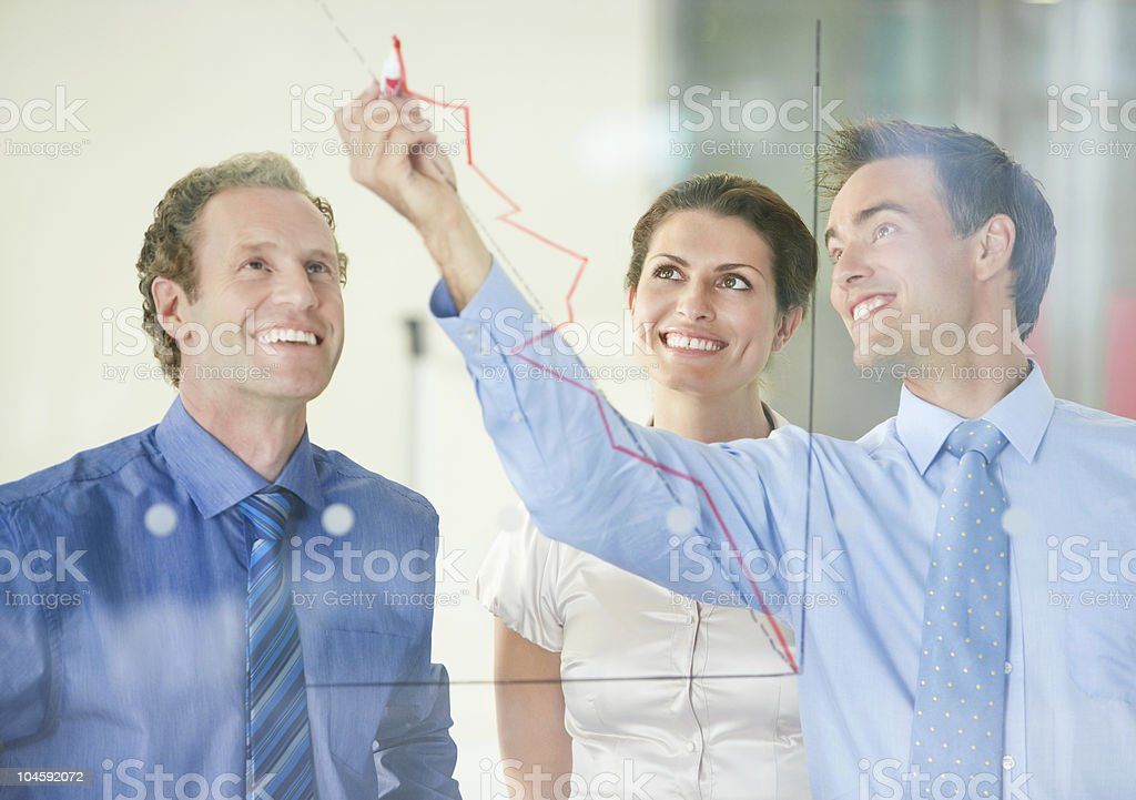 Smiling business people having a meeting on business development royalty-free stock photo