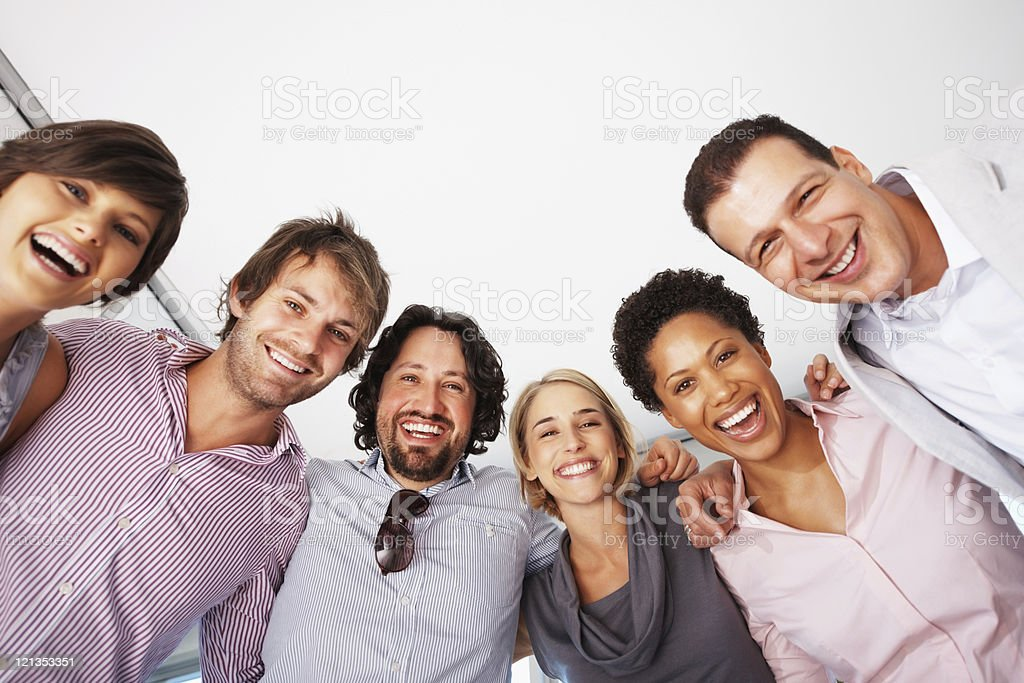 Smiling business people in a huddle royalty-free stock photo